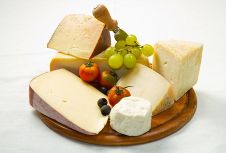 composition of different type of cheese on wooden board photo