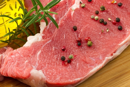 specialty: raw T-bone with rosemary and pepper