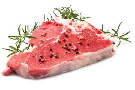 raw T-bone with rosemary on white background