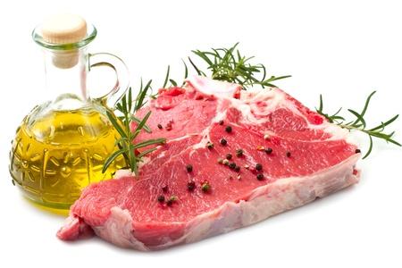 t bone steak: raw T-bone with rosemary on white background