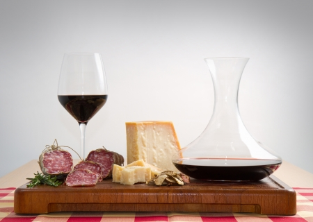bread parmesan cheese  salami and red  wine photo