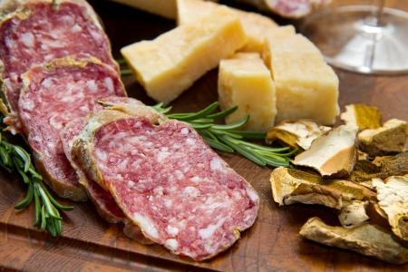 italian salami: bread parmesan cheese and salami  Stock Photo