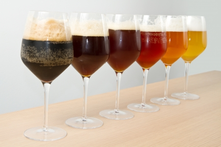 Six glasses with different beers on wooden table Stock Photo - 16278028
