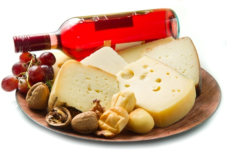 Red wine with  cheese selection over white  photo