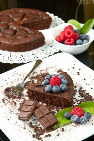 Piece of chocolate cake with fresh berry  photo