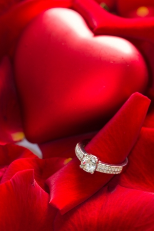 Golden diamond ring and red rose petals Stock Photo - 16790434
