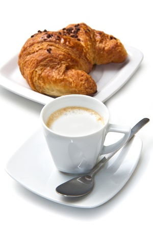 croissants: Cup of coffee with croissants isolated in white  Stock Photo