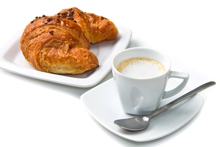 Cup of coffee with croissants isolated in white  photo