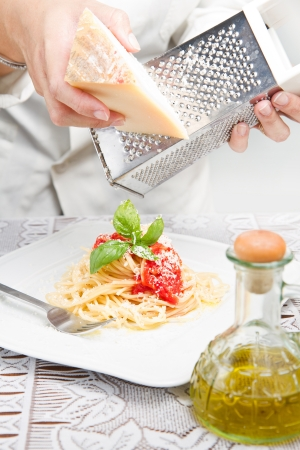 itakian pasta with grated parmesan  photo