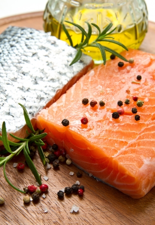 Fresh salmon fillet on wooden board with pepper and rosemary Stock Photo - 16957695