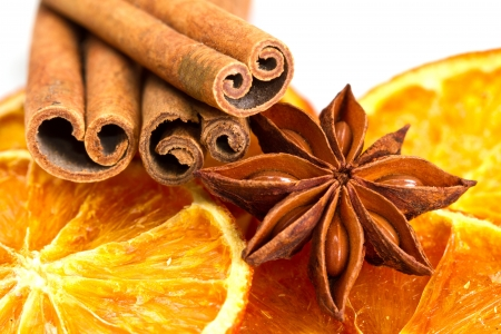 Cinnamon sticks, star anise and dried orange cuts  Stock Photo - 17088877