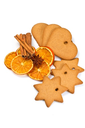 biscuits with  cinnamon and  orange dried on wooden table photo