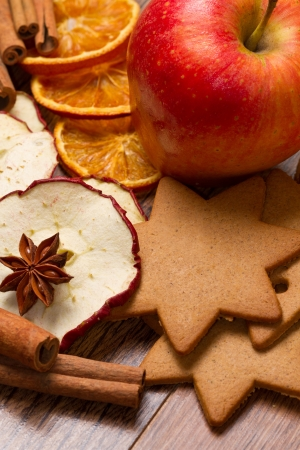 fresh apple with biscuit,cinnamon and fruit dried on wooden table photo