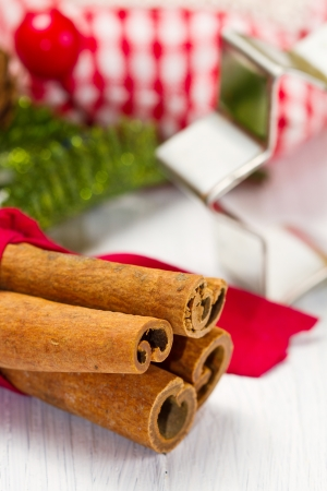 cinnamon sticks with decoration on white photo