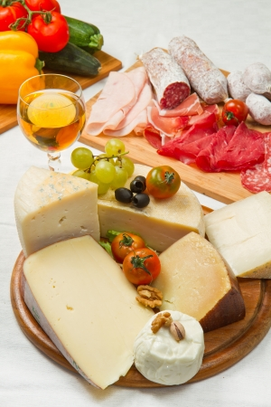composition of cold cuts  with different cheese photo