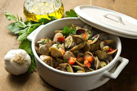 bowl with delicoius clams soup on wooden table Stock Photo - 17453594