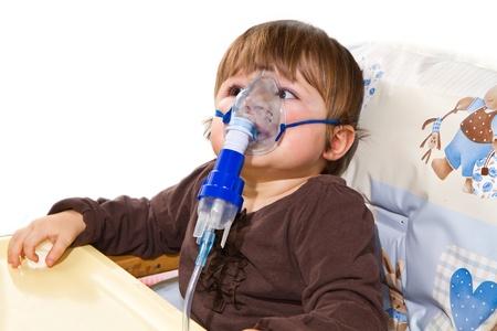 bronchitis: child taking respiratory, inhalation therapy