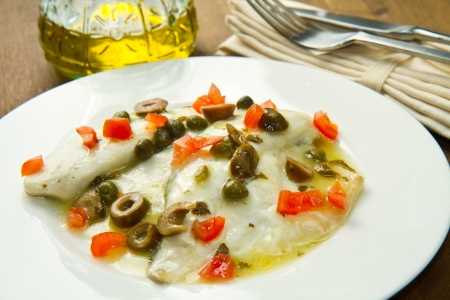 sea bream fillet with tomatoes, green olives and capers Stock Photo - 17842700