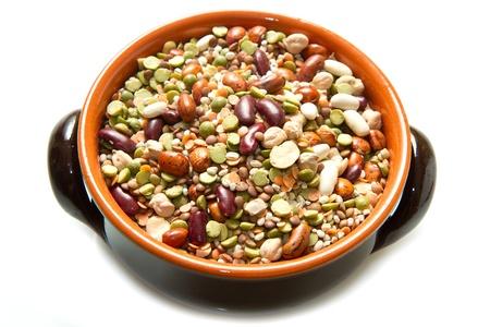 crock pot: vegetables in crock pot on white background Stock Photo