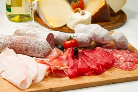 beef cuts: composition of cold cuts  on wooden board with different type of cheese  Stock Photo