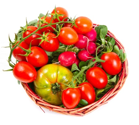 mouthwatering: tomatoes in a basket, isolated on white