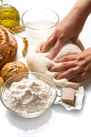 female hands in flour closeup kneading dough on table  Stock Photo