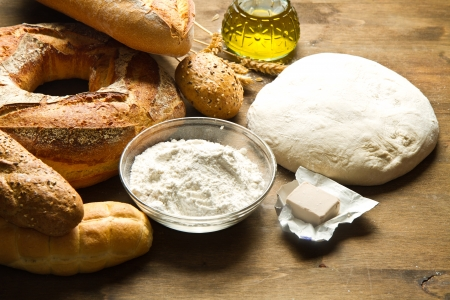 ingredients for homemade bread on wooden background Stock Photo - 18669719