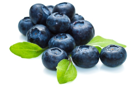 blue berry over white background and green leaf photo