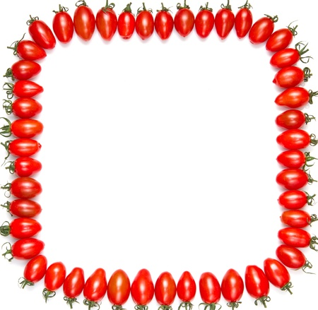 frame of red tomatoes isolated on a white background  photo