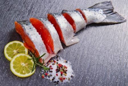 pink salmon: slice of fresh salmon with lemon , salt and pepper