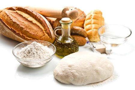 ingredients for homemade bread on white background photo
