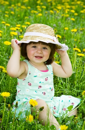 Happy girl on the meadow with white flowers photo