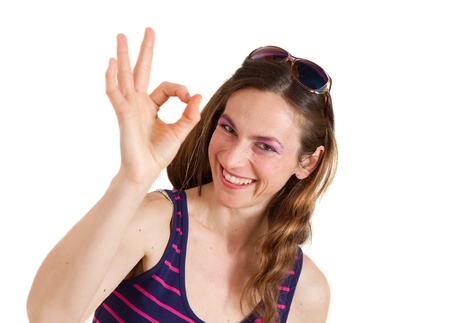 smiling girl showing OK sign photo