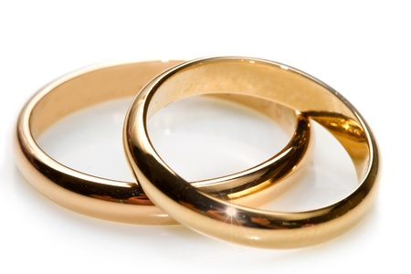 couple of gold wedding rings on white background photo
