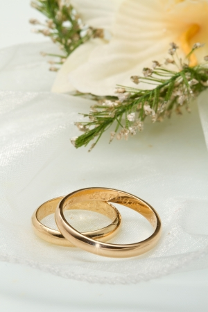 Wedding rings with orchid bouquet photo