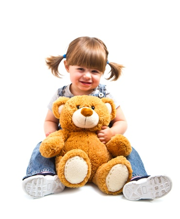 toy bear: adorable toddler girl hugging a teddy bear Stock Photo