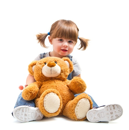 adorable toddler girl hugging a teddy bear photo