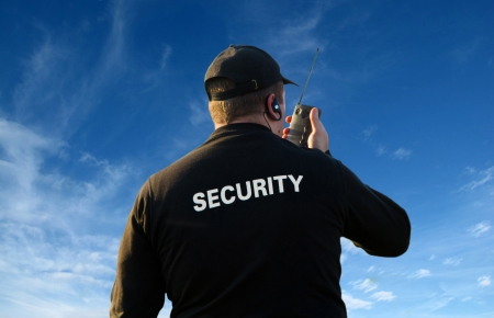 safety jacket: back of a security guard                     Stock Photo