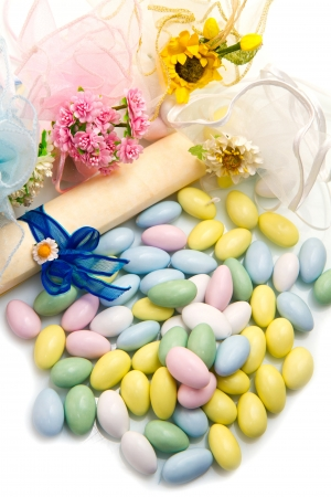 different colored candy favor on white background photo