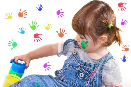 tempera: a baby girl artist playing with colors