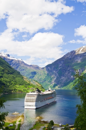anchoring: Cruise ship in  Norwegian fjords Stock Photo