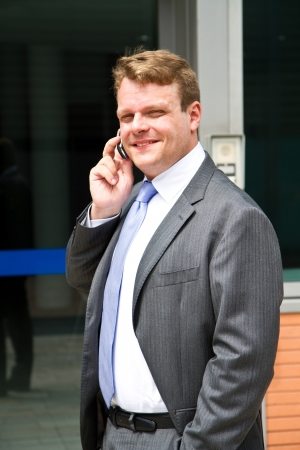 Portrait of a young businessman talking on the phone  Stock Photo - 20444086