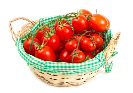 ripe cherry tomatoes on a white background  photo