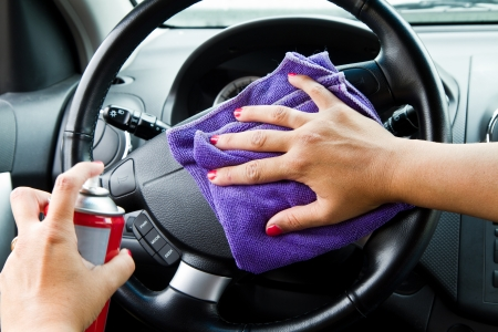 Woman Hand with a wipe the car polishing  photo