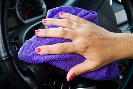 Hand with a wipe the car polishing  photo