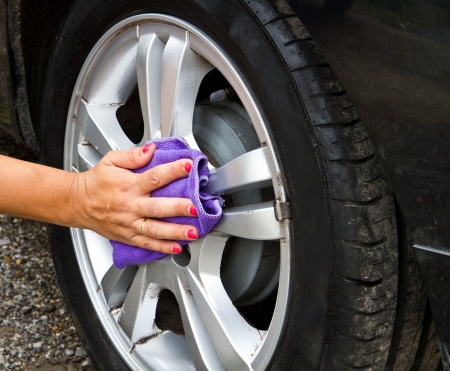 Outdoor tire car wash with  sponge photo