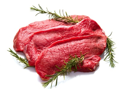 a red meat with  rosemary isolated on white background  photo