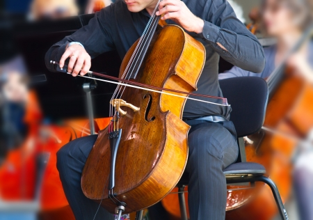 cellos: close-up of cellos being played in a concert