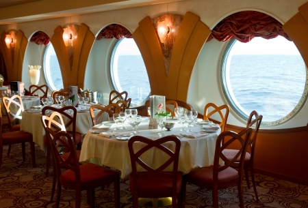 dinner cruise: restaurant on board a cruise ship ready for dinner