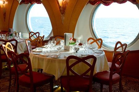 dinner cruise: restaurant on board a cruise ship ready for dinner